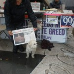 "The ""Washington OCCUPIED Post""  newspaper is OWS DC's own weekly publication.   The Information Tent is in the background."