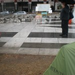 The marble ground cover is a big asset for the tent city as opposed to a dirt surface.  We pointed out how readily city water lines from the nearby fountain and sanitary sewer lines at curb side in the adjoining street could be accessed if so desired by the officials.